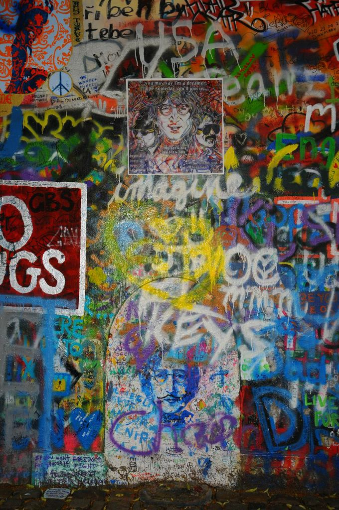 1M7AjgDjSfSmb9MWUTlg_CustomMade-painting-commemorating-lost-loved-ones-on-the-John-Lennon-wall-in-Prague.jpeg