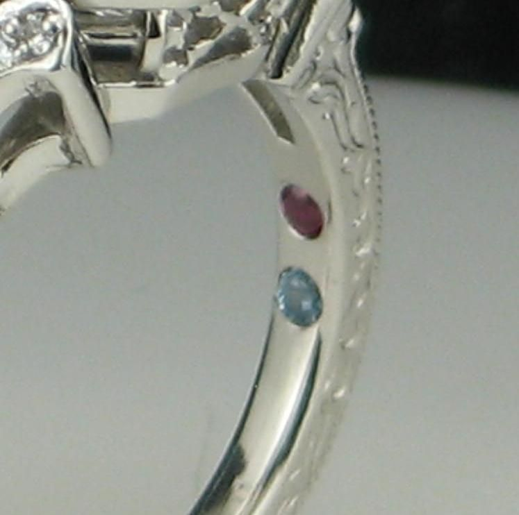 23rssd3YR92CzXClq7v4_Engagement-ring-with-birthstones-on-the-inner-band-via-CustomMade.jpeg