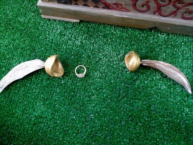 the snitch opened up to hold the engagement ring which was also created on custommade by jim grahl - Harry Potter Wedding Rings