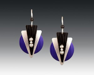 Composed of circles triangles and spheres and with rich purple silver and black colors these Art Deco-style anodized aluminum and sterling silver earrings by Mendy Marks Fine Jewelry pop with an almost electric glow.  The Art Deco period is Mendy's favorite and she can create custom earrings like these in your choice of colors or in another Art Deco design.  CustomMade.com