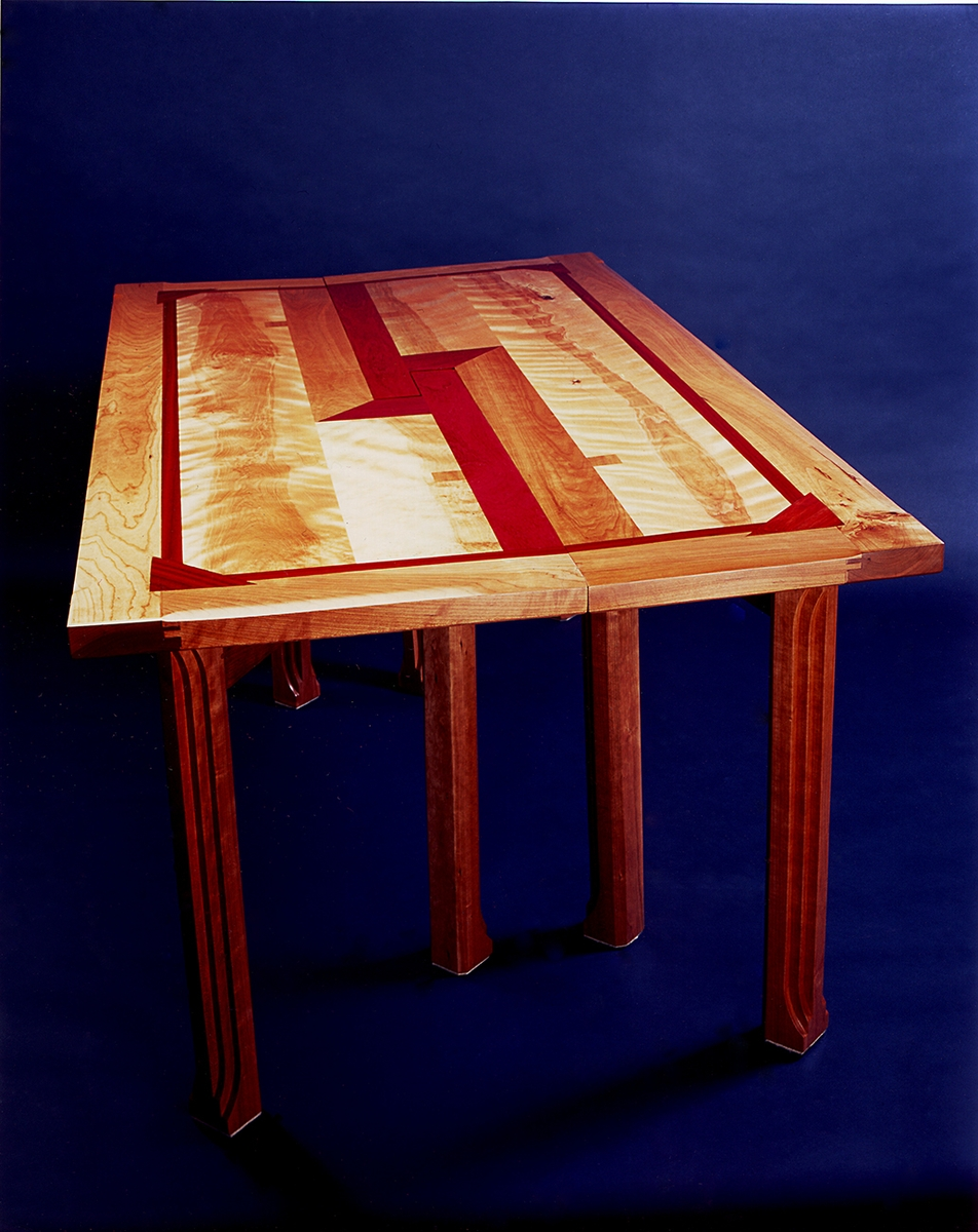 LCuISLUZS0mcHs63b1wk_Table-with-Eight-Legs-by-Burgeonwood-Inc.-at-CustomMade.com_.jpg