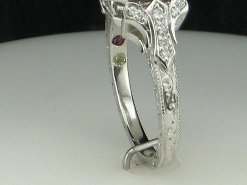 PoKxlURbTHePl7x90eh1_Engagement-ring-with-inlaid-birthstones-for-family-members-via-CustomMade.jpeg