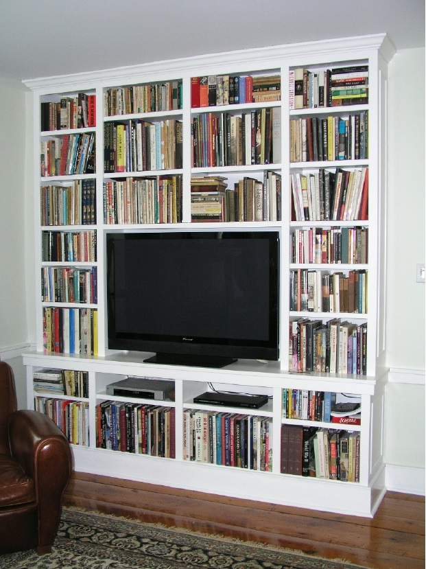 A 52 flat-screen surrounded by books.  Widescreen TV Cabinet and Library by Tony O'Malley Custom Woodworking at CustomMade.com