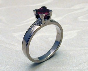 Contemporary Art Deco Style Engagement Ring with Ruby in 4-Claw Fishtail Setting and Pave Set Diamonds by Metamorphosis Jewellery Workshop at CustomMade.com