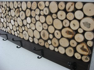 This custom rustic wood coat/towel rack by Modern Rustic Art was made from fallen maple branches that were cut and assembled so that the unique bark growth rings and shapes of the individual pieces add an organic counterpoint to the modern frame and hooks.  CustomMade.com