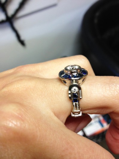 Emily showing off the side of her R2D2 engagement ring - the detail is really amazing. Another one-of-a-kind project and story on CustomMade. Joe and Emily are the best!
