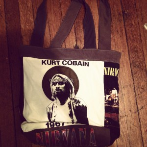 You provide the old T-shirts and memories.  Project Repat will upcycle them into new chic clothing or accessories like this Nirvana-themed custom T-shirt tote bag.  CustomMade.com
