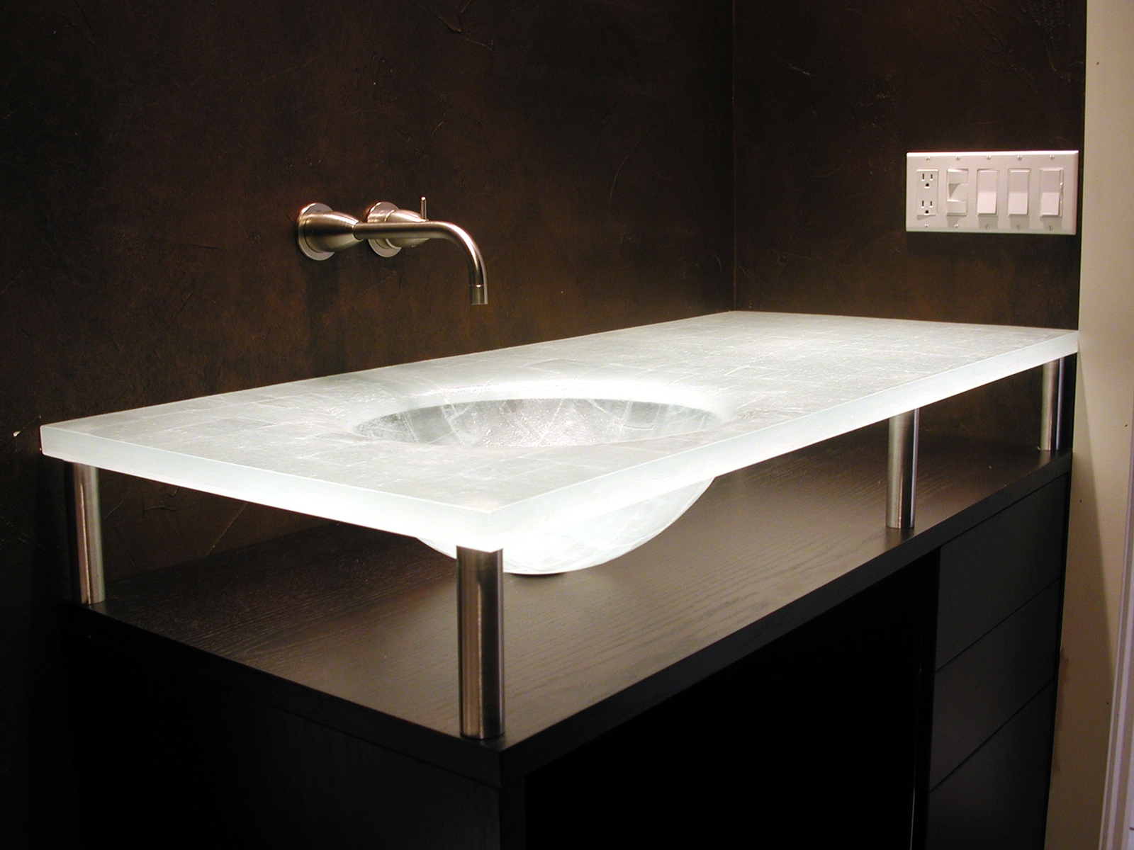 All In One Bathroom Sink And Countertop : Stainless steel posts support a hand-cut glass countertop and sink ...