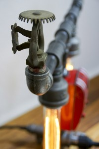 Reclaim, Reverse, Resurrect: Fire Sprinkler Lamp Side View Photograph