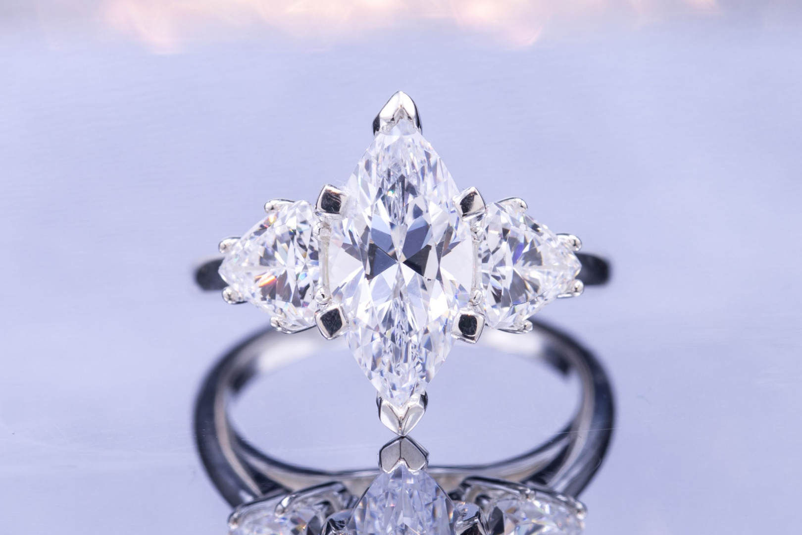 Three-stone cubic zirconia ring with marquise center stone and trillion cut side stones