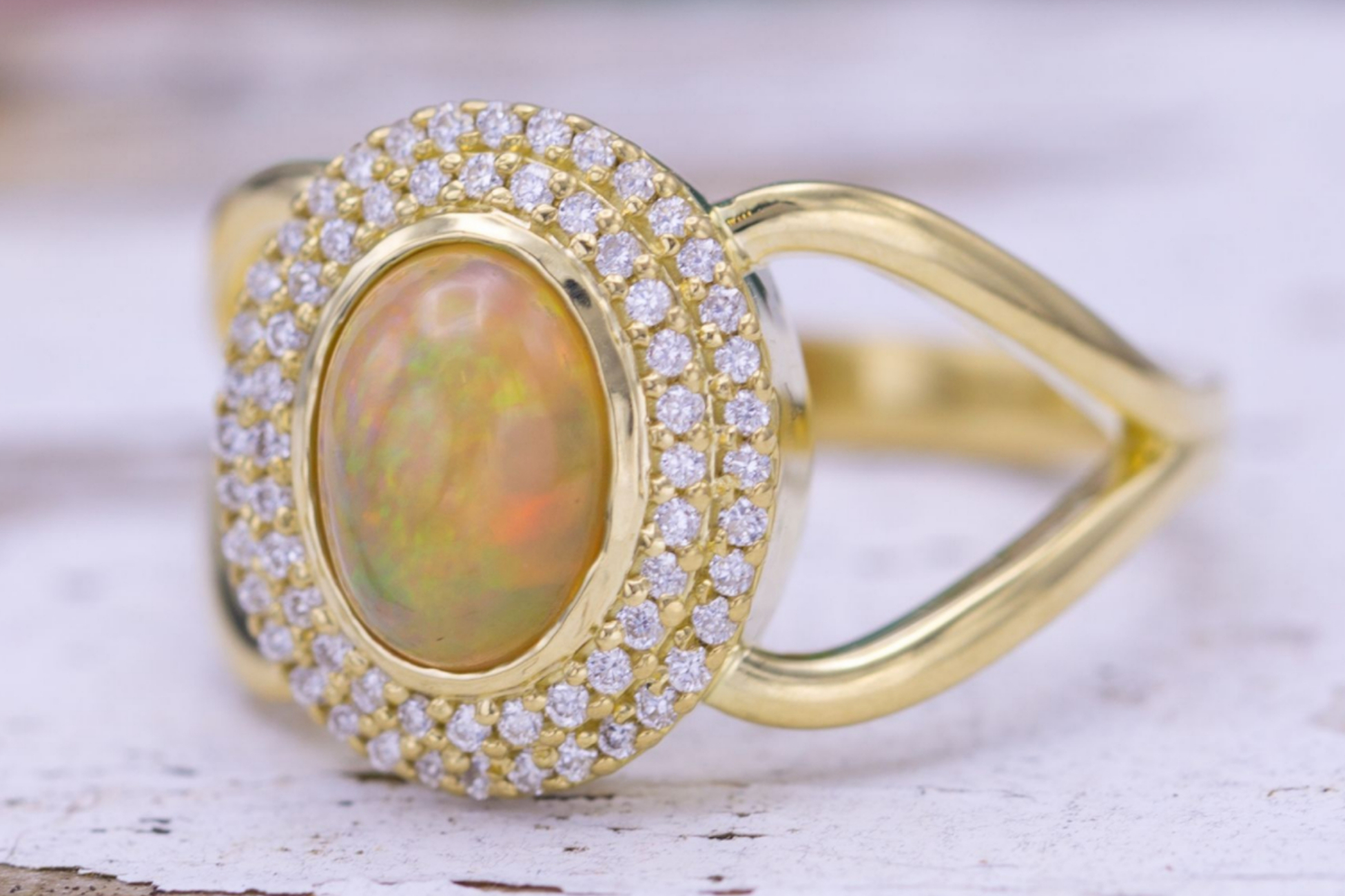 Double halo engagement ring with yellow opal and diamonds
