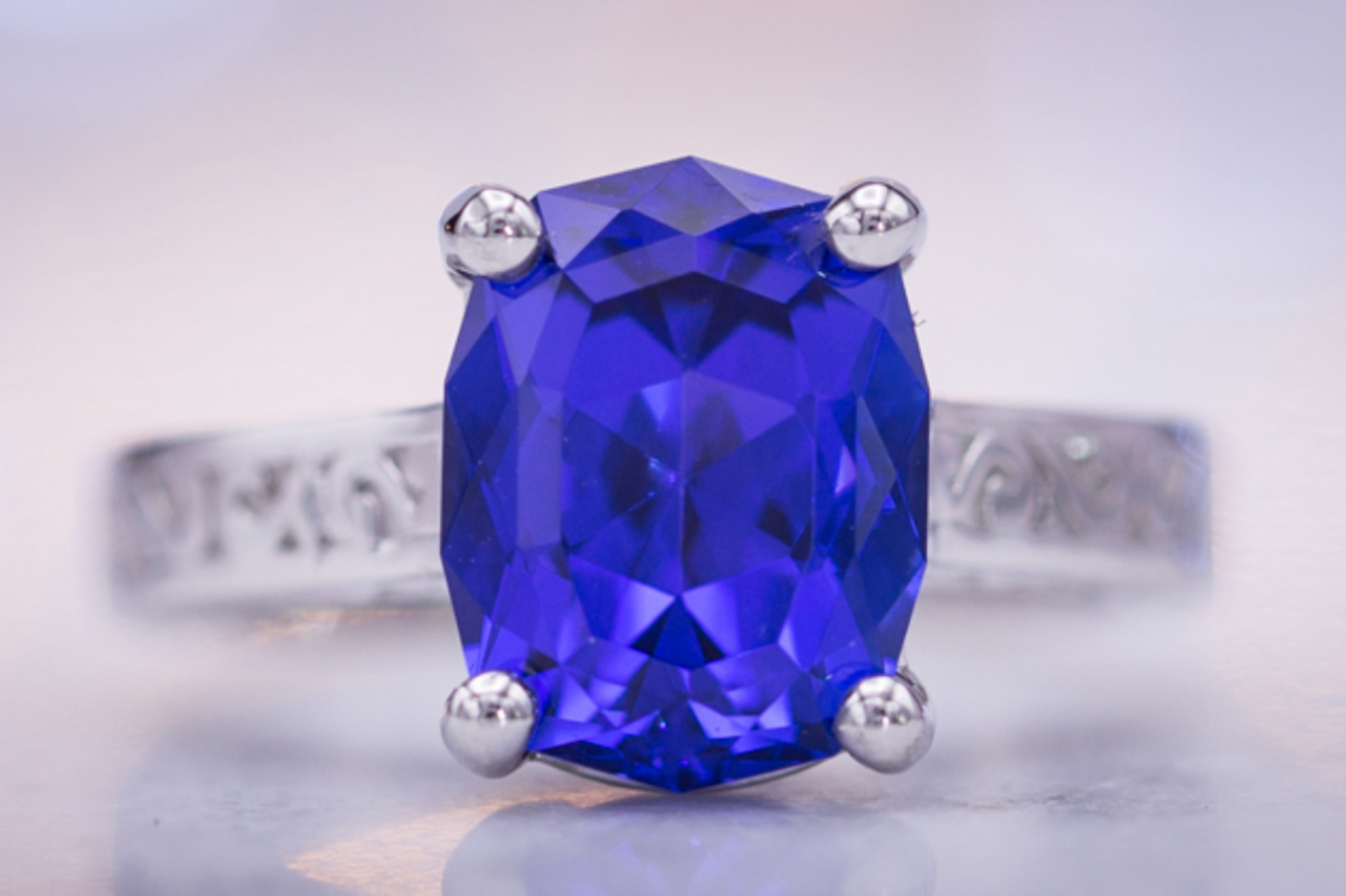 Platinum engagement ring with custom cut elongated cushion tanzanite