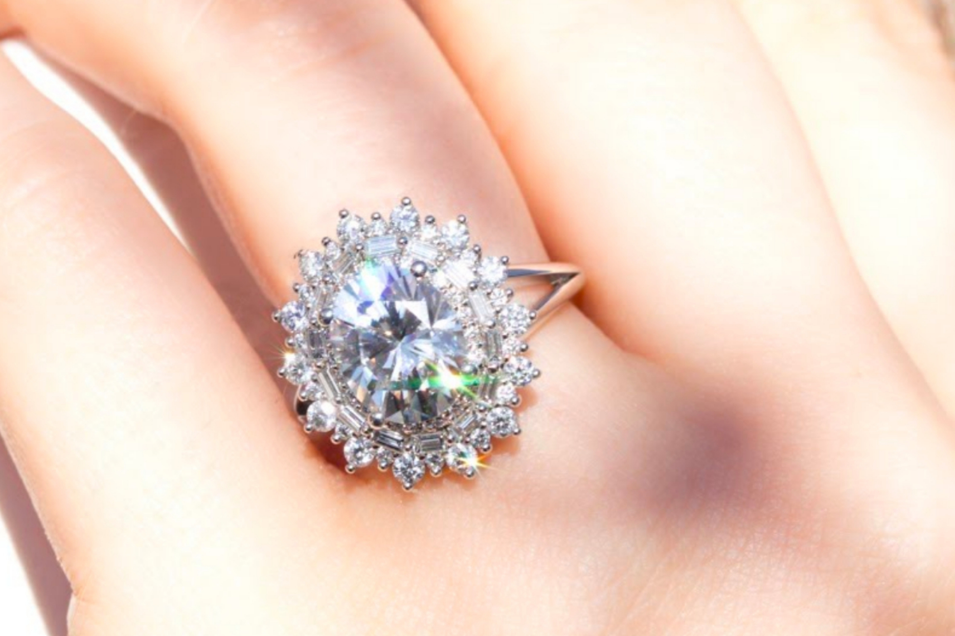 Glamorous engagement ring with triple sunburst halo