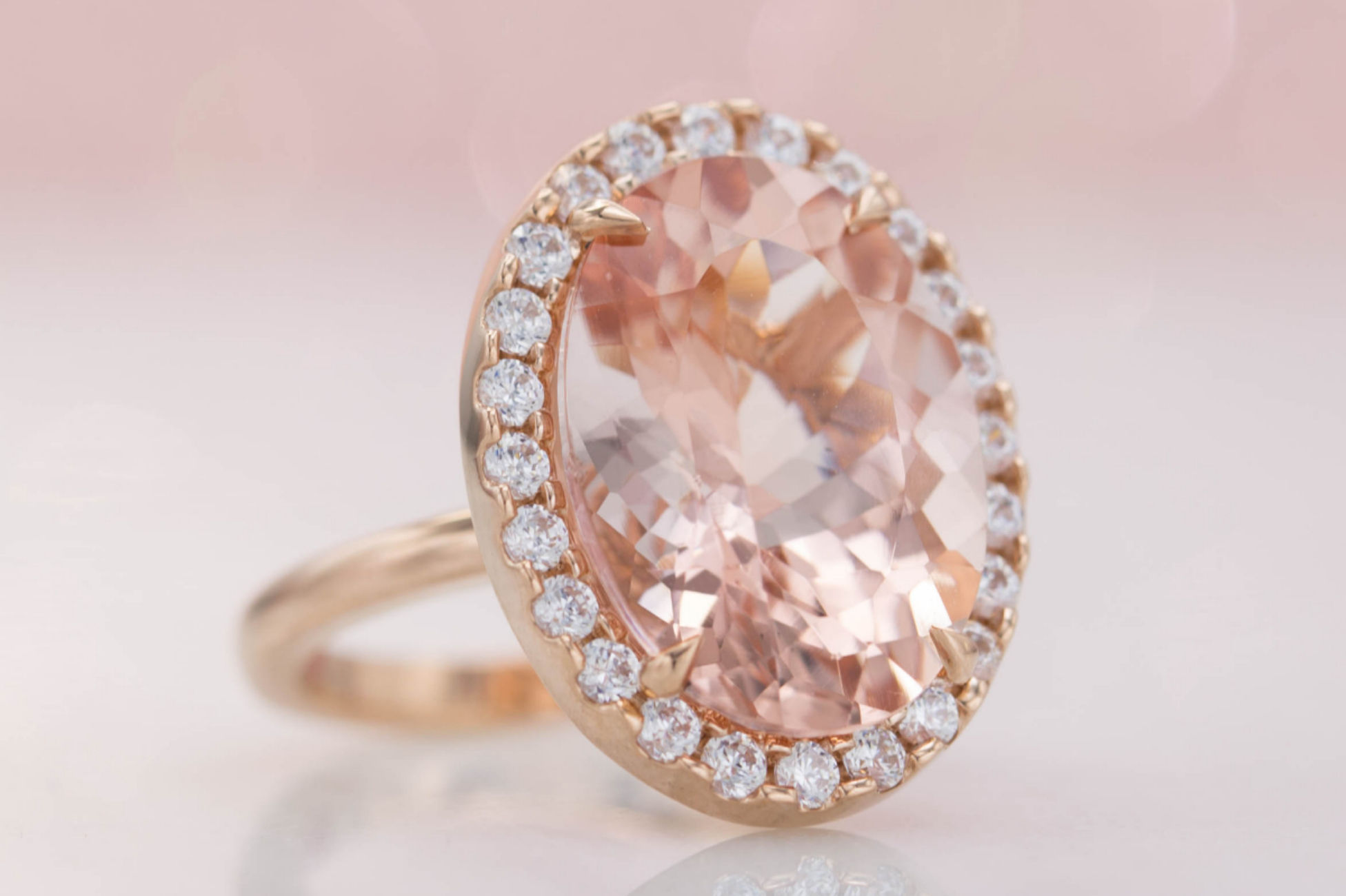 Halo engagement ring with huge oval morganite center stone