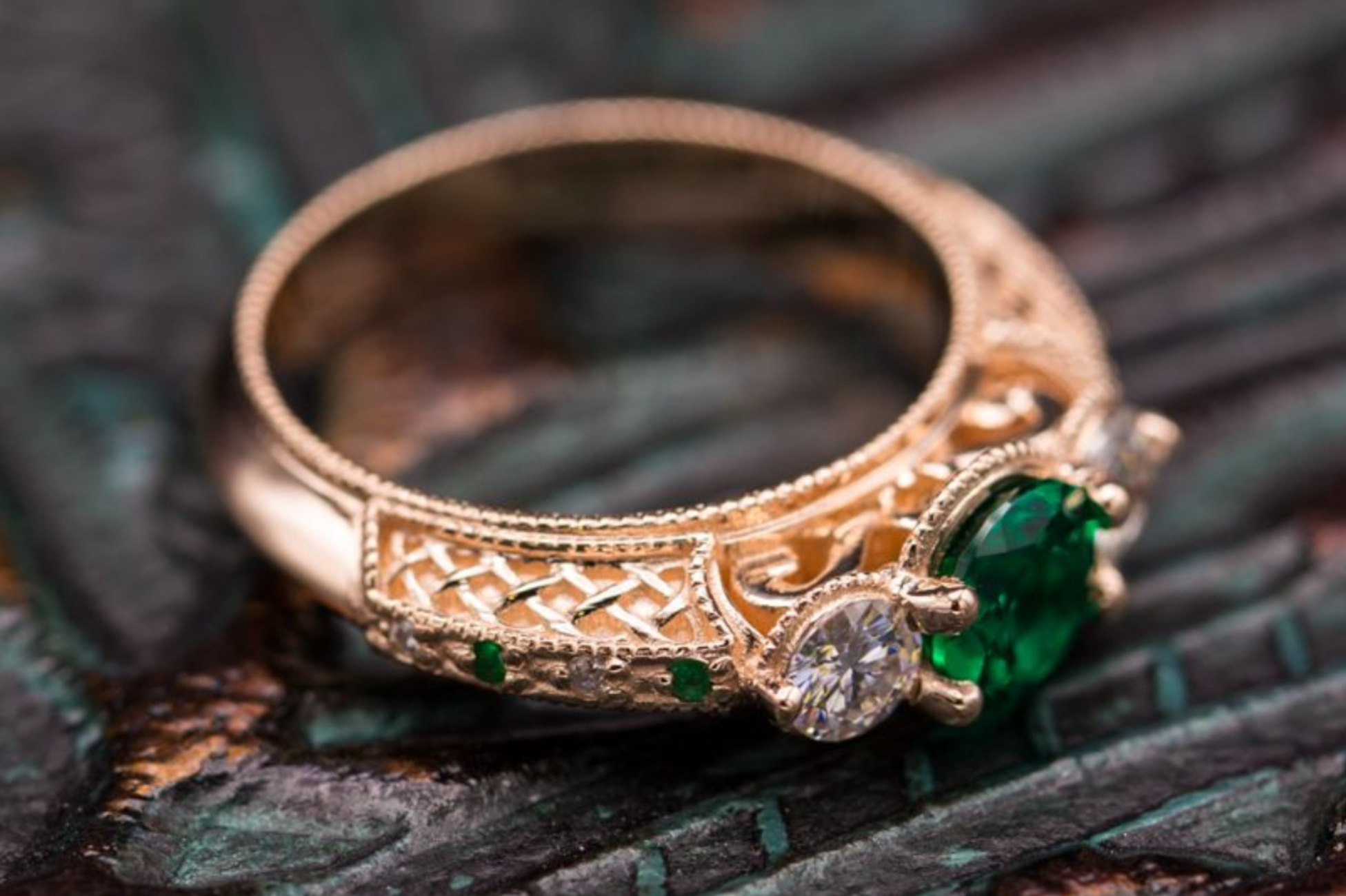 Vintage-inspired rose gold ring with three stone emerald and moissanite setting