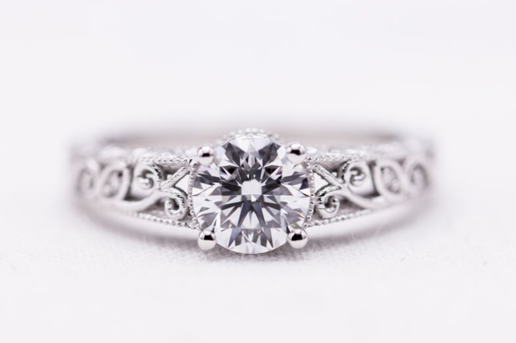 Delicate white gold filigree engagement ring with lab created diamond