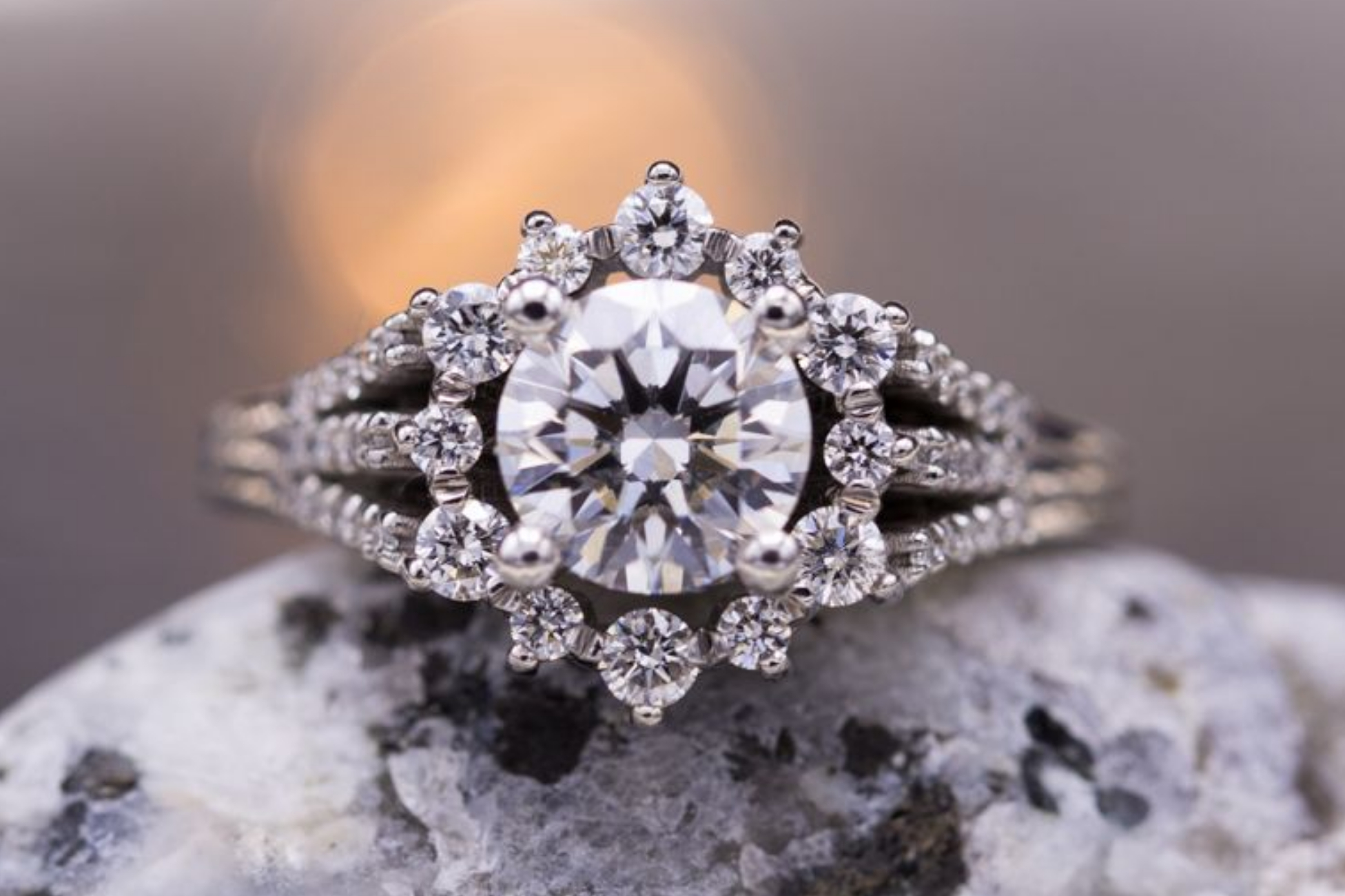 Sunburst halo diamond engagement ring