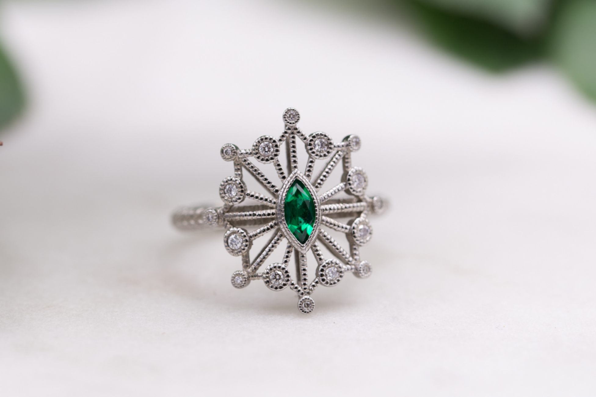 Vintage-inspired snowflake emerald ring