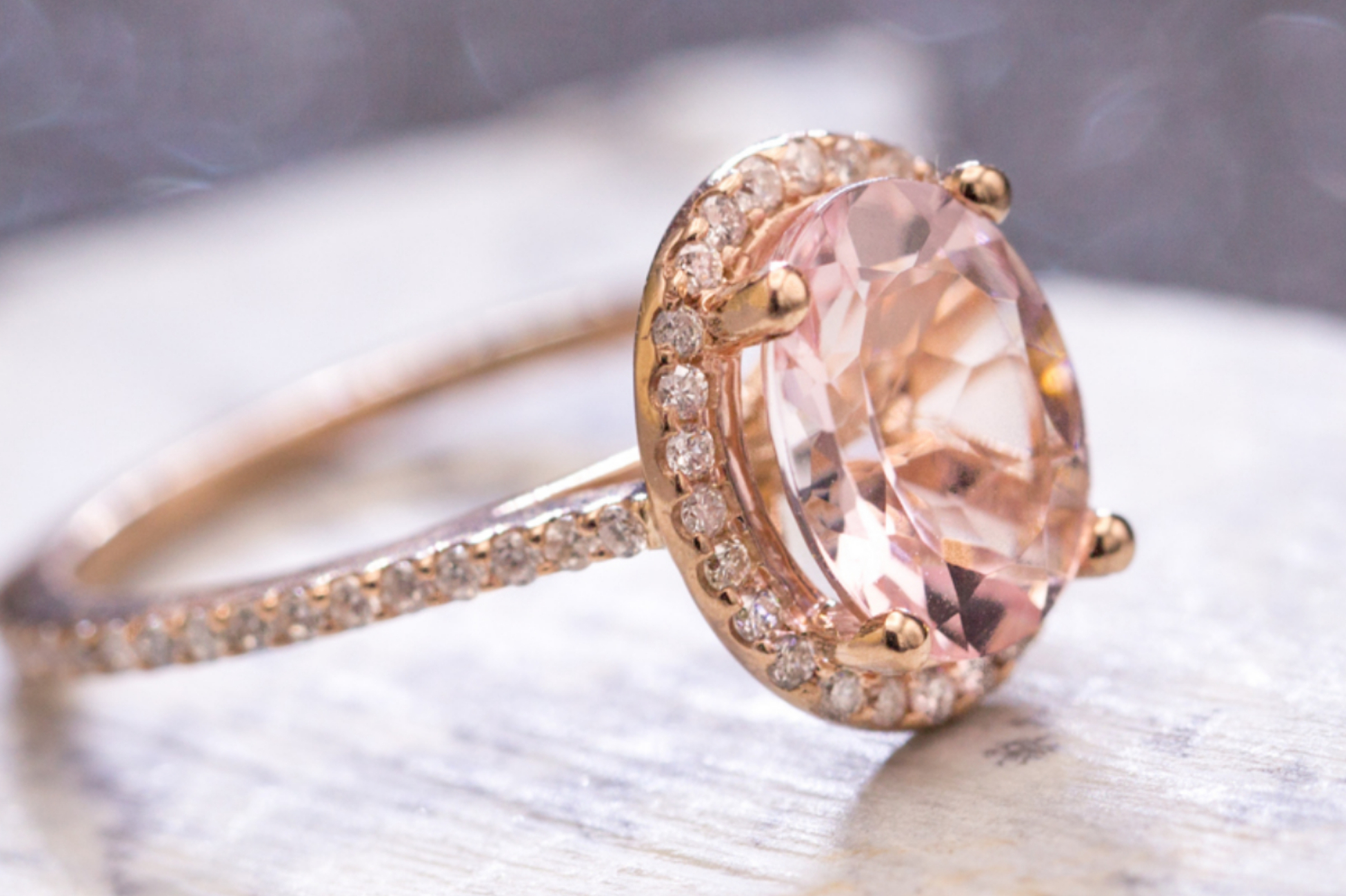 Rose gold halo engagement ring with oval cut morganite