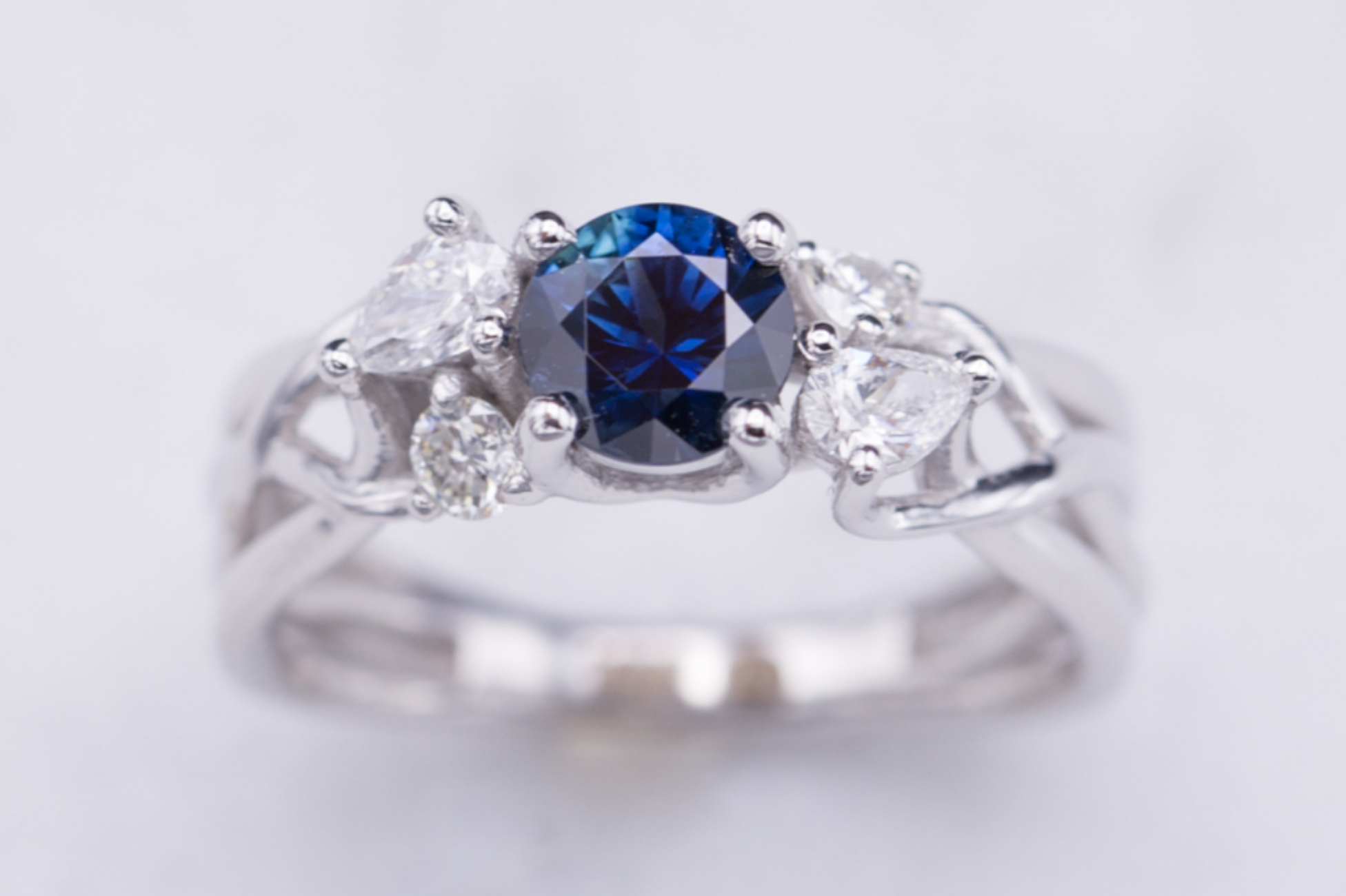 Sapphire and diamond engagement ring on delicate white gold strands