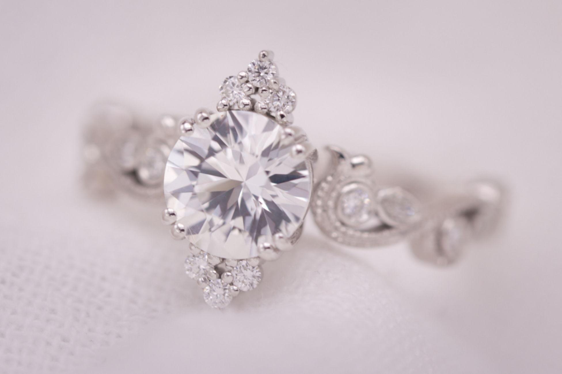 Regal engagement ring with white sapphire