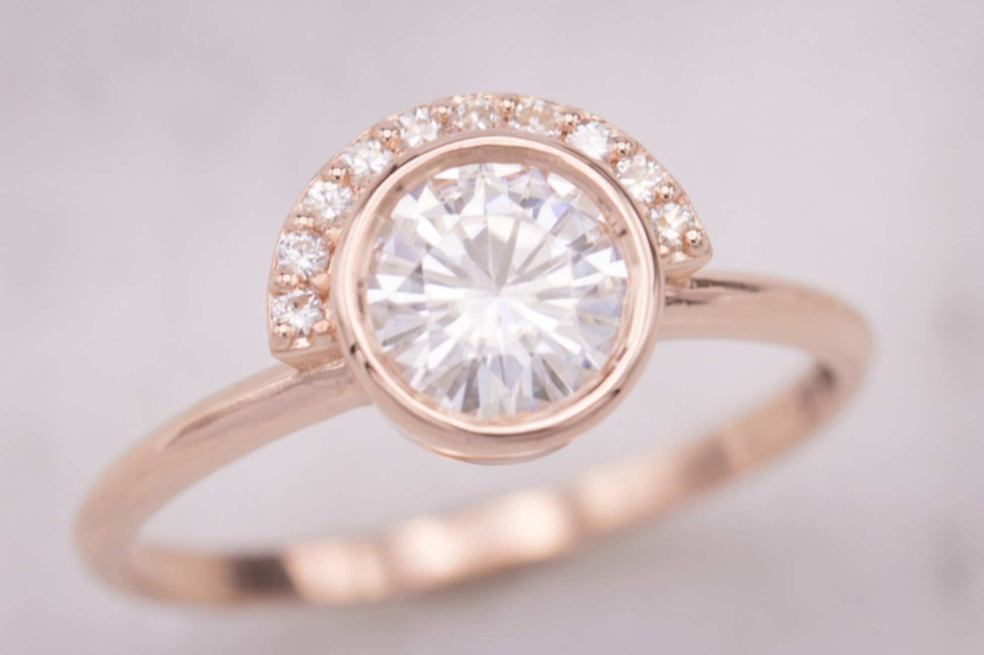 Modern engagement ring with half-halo